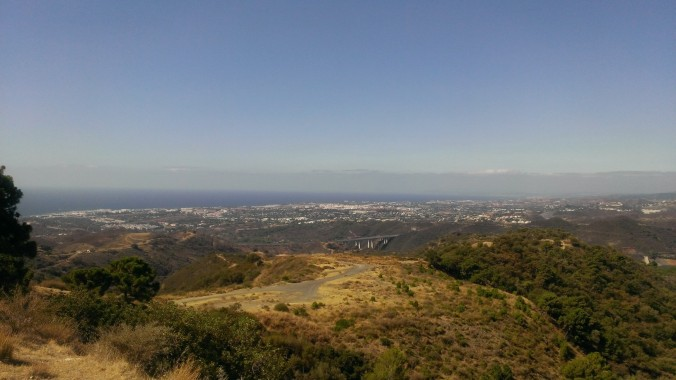 view of the coast from the Sierra de Las Nieves biosphere