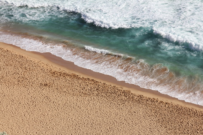 surf on a sandy shore