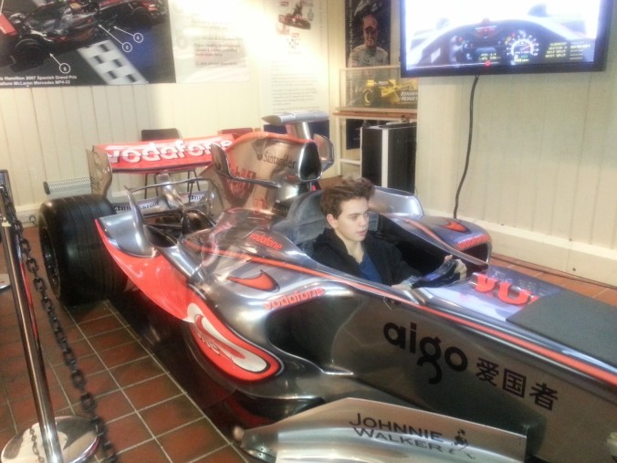 Wills enjoying the F1 simulator in Lewis Hamilton's 2008 McLaren show car.