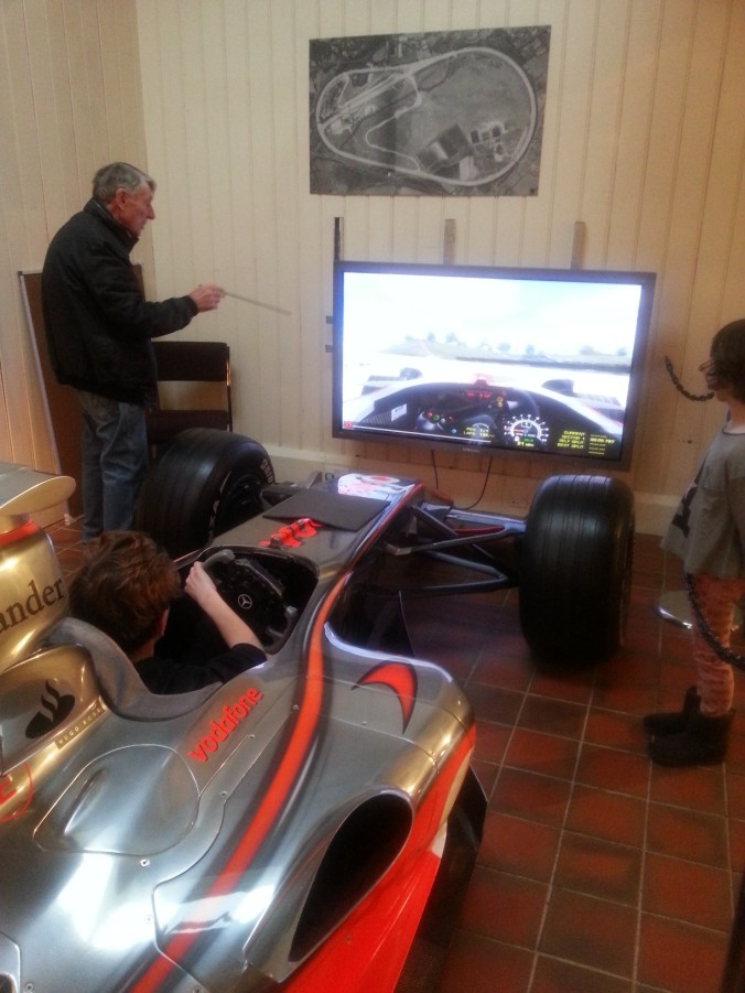 Will on F1 simulator behind